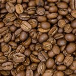 brown-coffee-beans-on-white-ceramic-plate